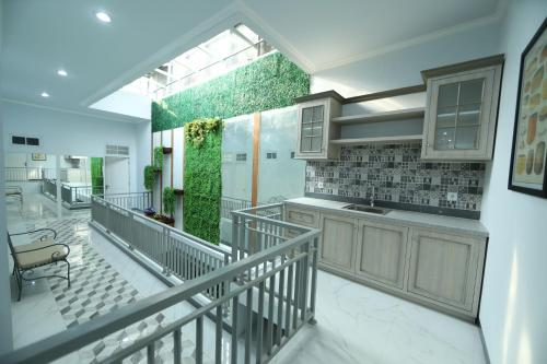 A kitchen or kitchenette at Nest Residence