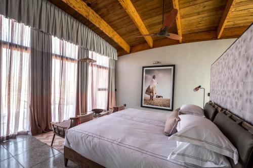 Un ou plusieurs lits dans un hébergement de l'établissement The Desert Grace