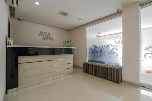 The lobby or reception area at RedDoorz Plus near Galaxy Bekasi
