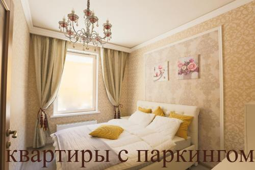 Кровать или кровати в номере Complex Apartments near Novodevichiy