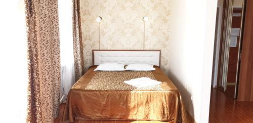 Кровать или кровати в номере Гостиница Пять Звёзд