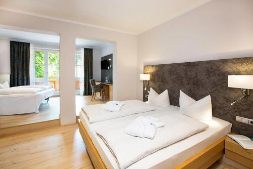 Ein Bett oder Betten in einem Zimmer der Unterkunft Vital Hotel Wiedemann