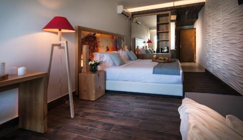 A bed or beds in a room at Elounda Orama