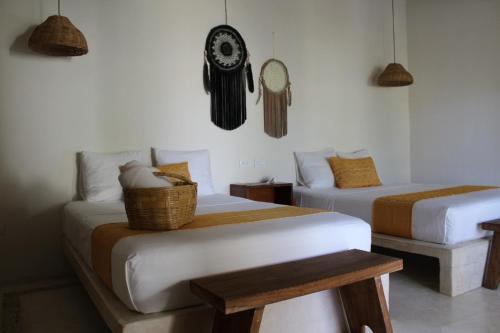 Ein Bett oder Betten in einem Zimmer der Unterkunft Tierra Mia Boutique Hotel