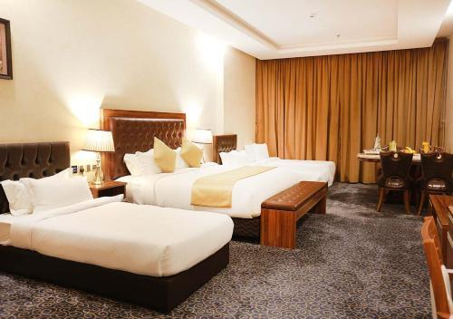 Cama ou camas em um quarto em Karam Jeddah Hotel