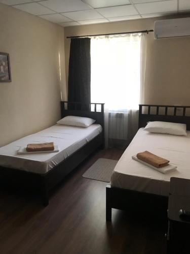Кровать или кровати в номере База отдыха Эврика