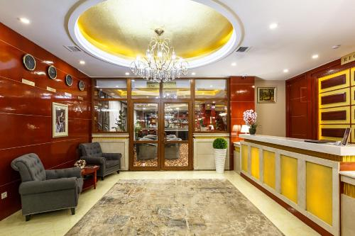 The lobby or reception area at Renion Residence Hotel