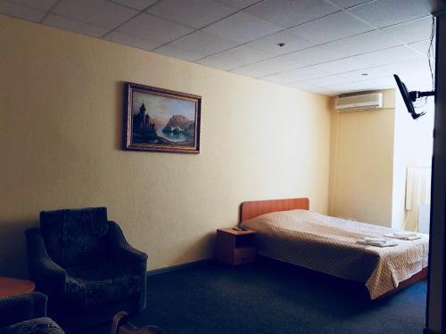 """Ліжко або ліжка в номері Мини отель """"На Индустриальном"""""""