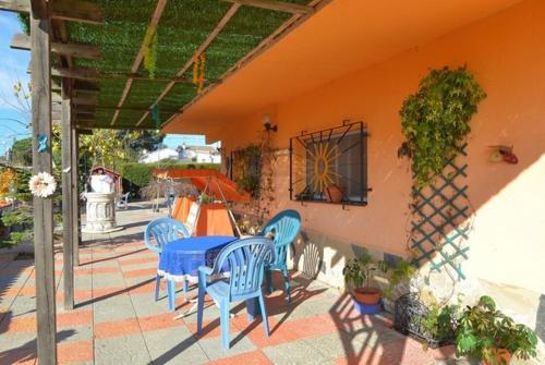 A porch or other outdoor area at Vallcanera Villa Sleeps 5 Pool