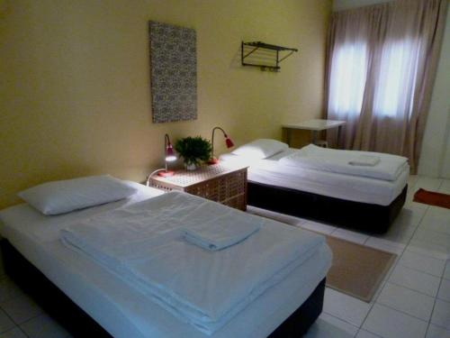 A bed or beds in a room at Orange Pekoe Homestay