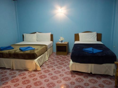 A bed or beds in a room at Gypsy Village 2