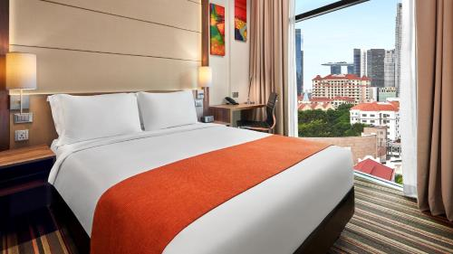 A bed or beds in a room at Holiday Inn Express Singapore Clarke Quay (SG Clean), an IHG Hotel