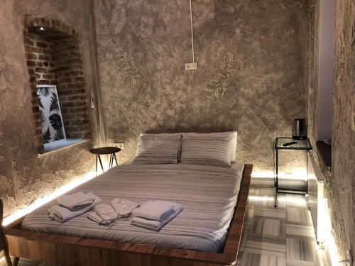 سرير أو أسرّة في غرفة في شقق كومباني – شقة موجان