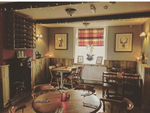 A restaurant or other place to eat at The Hinds Head Hotel