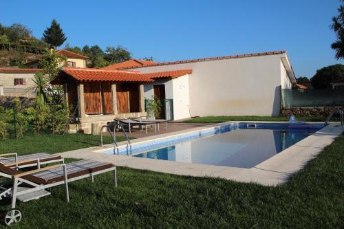 The swimming pool at or near Casa da Capela