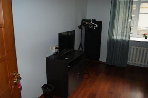 Телевизор и/или развлекательный центр в Light House