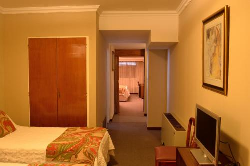 A bed or beds in a room at Hotel Centro