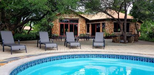 The swimming pool at or close to Belvedere Game Ranch