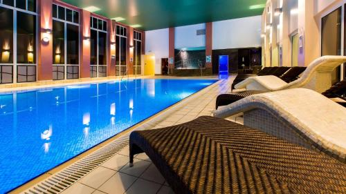 The swimming pool at or near DoubleTree by Hilton Forest Pines Spa & Golf Resort