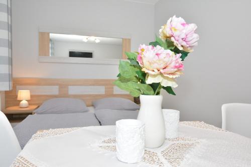 A bed or beds in a room at Pokoje Gościnne Nowa Grań