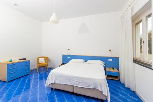 A bed or beds in a room at Residence Due Torri