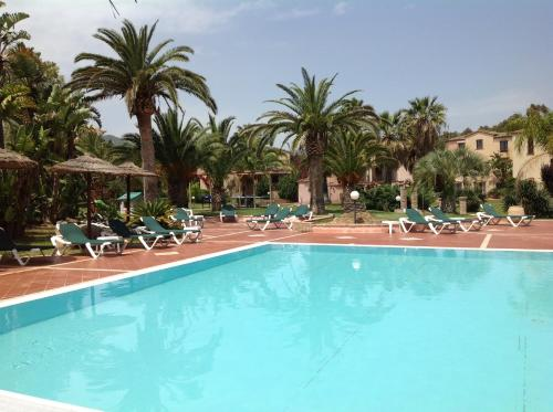 The swimming pool at or near Residence Baia Delle Palme
