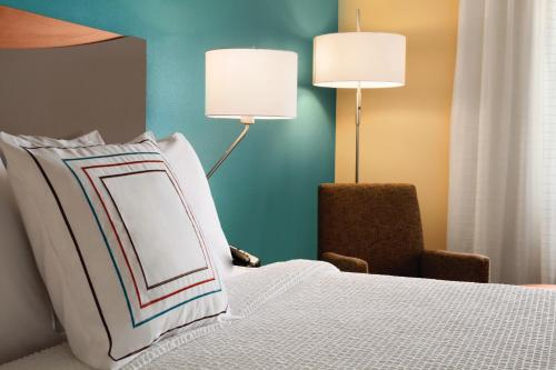 A bed or beds in a room at Fairfield Inn & Suites Stevens Point