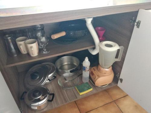 A kitchen or kitchenette at Vitrine apart. Hotel