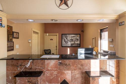 The lobby or reception area at Super 8 by Wyndham Dallas East