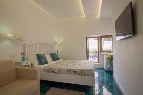 A bed or beds in a room at Residenza Villa Celeste