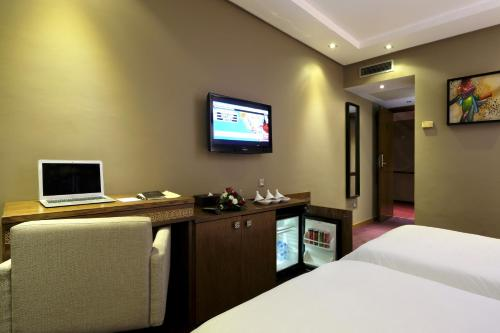 A television and/or entertainment center at Belere Hotel Rabat