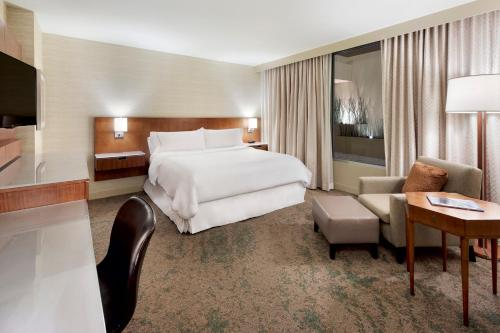 A bed or beds in a room at The Westin Minneapolis