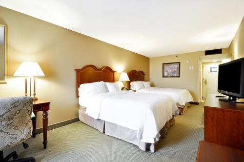 A bed or beds in a room at Hampton Inn Charleston-Historic District