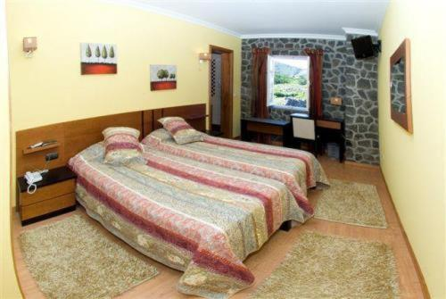 A bed or beds in a room at Casa Das Faias