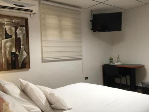 A bed or beds in a room at Aital