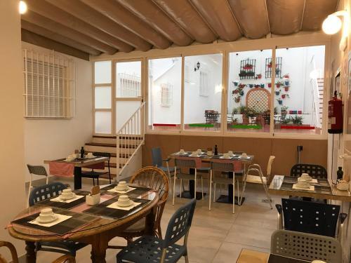 Un restaurante o sitio para comer en Hotel Infante Antequera
