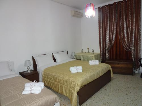 A bed or beds in a room at B&B DODO
