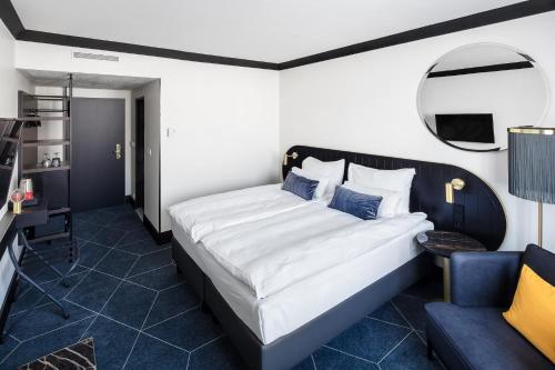 Ein Bett oder Betten in einem Zimmer der Unterkunft Vienna House Diplomat Prague