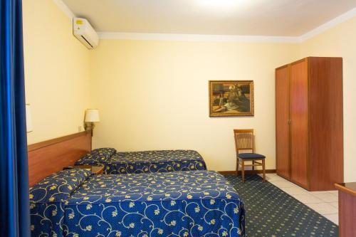 Letto o letti in una camera di Hotel Ristorante Paladini
