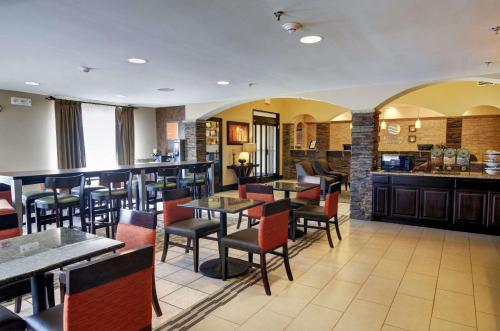 A restaurant or other place to eat at Comfort Inn and Suites Medical West