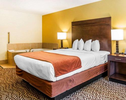 A bed or beds in a room at Quality Inn & Suites Montclair