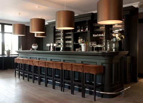 Лаундж или бар в Fletcher Hotel-Restaurant Duinzicht