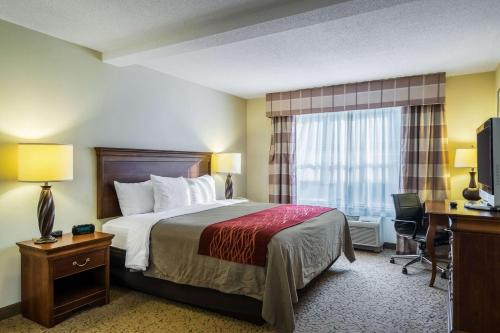 A bed or beds in a room at Comfort Inn & Suites Dover