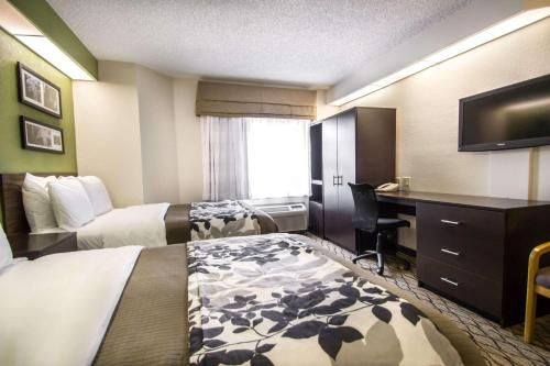 A bed or beds in a room at Sleep Inn Miami Airport