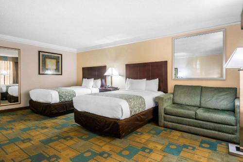 Cama ou camas em um quarto em Quality Inn At International Drive Orlando