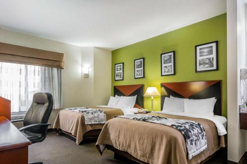 A bed or beds in a room at Sleep Inn near The Avenue