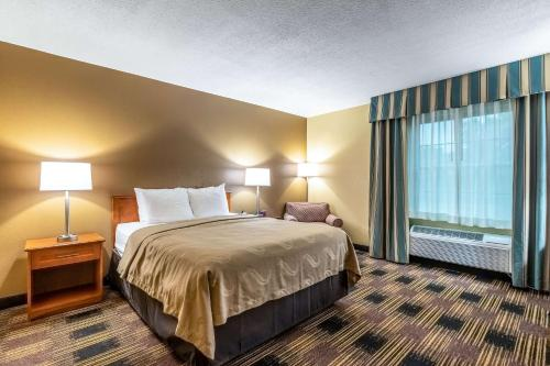 A bed or beds in a room at Quality Inn Newton