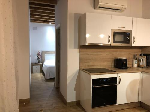 A kitchen or kitchenette at Apartamentos Rosario 1