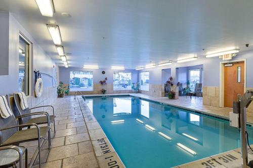 The swimming pool at or near Quality Inn & Suites Northampton - Amherst