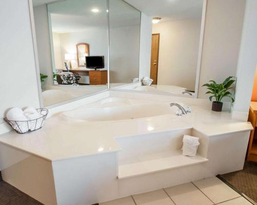 A bathroom at Sleep Inn & Suites Lake of the Ozarks